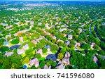 green horizon suburban growth... | Shutterstock . vector #741596080