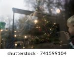 young family decorating the...   Shutterstock . vector #741599104