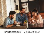 group of  friends sitting at... | Shutterstock . vector #741605410