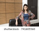 a beautiful businesswoman is... | Shutterstock . vector #741605560