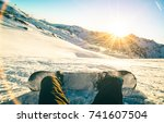 snowboarder sitting at sunset... | Shutterstock . vector #741607504