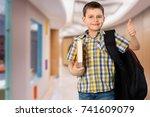 happy school child. | Shutterstock . vector #741609079