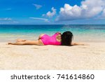 beautiful brunette on the shore ... | Shutterstock . vector #741614860