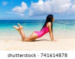 beautiful brunette on the shore ... | Shutterstock . vector #741614878