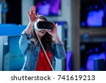 girl having fun trying new 360... | Shutterstock . vector #741619213