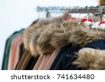Small photo of Fur collar jackets on sale rack