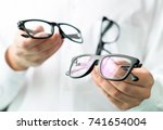optician comparing lenses or... | Shutterstock . vector #741654004