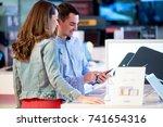 couple shopping for latest... | Shutterstock . vector #741654316