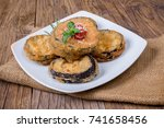 round eggplant blanched with... | Shutterstock . vector #741658456