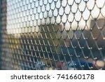 iron mesh close up | Shutterstock . vector #741660178