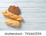 fresh bread on wooden table.... | Shutterstock . vector #741662554