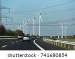 wind turbines near highway.... | Shutterstock . vector #741680854