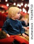 cute toddler boy watching... | Shutterstock . vector #741698710