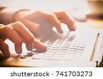a closeup of an office worker... | Shutterstock . vector #741703273