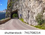 ascending mountain road and... | Shutterstock . vector #741708214