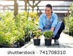 woman working in garden center    Shutterstock . vector #741708310