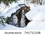 Small photo of Landscape of the Spring Forest. Airhole with Water from Melting Snow