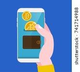 bitcoin transfer wallet hand... | Shutterstock .eps vector #741714988