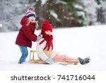 two funny little girls having... | Shutterstock . vector #741716044