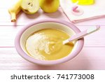bowl with baby food on table | Shutterstock . vector #741773008