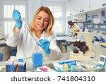female scientist in lab coat... | Shutterstock . vector #741804310