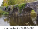 Small photo of The ancient stone built Shaw's Bridge over the River Lagan close to the little mill village of Edenderry on the outskirts of South Belfast in Northern Ireland