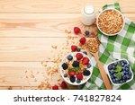 tasty granola with berries in... | Shutterstock . vector #741827824