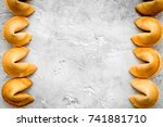 Small photo of Future prognostic with fortune cookie on stone background top view mock-up