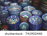 ethnic uzbek ceramic tableware. ... | Shutterstock . vector #741902440
