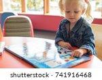little girl looking at a... | Shutterstock . vector #741916468