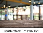 empty dark wooden table in... | Shutterstock . vector #741939154