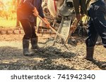 pouring concrete with worker... | Shutterstock . vector #741942340