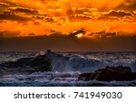 dramatic orange sunset over sea ... | Shutterstock . vector #741949030
