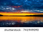 sunset orange over river... | Shutterstock . vector #741949090