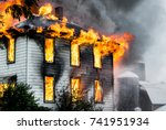 a house on fire and burning... | Shutterstock . vector #741951934