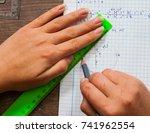 schoolgirl solves the problem... | Shutterstock . vector #741962554