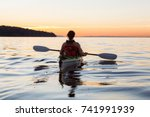 Woman On A Sea Kayak Is...