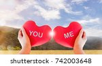 hand hold couple red heart with ... | Shutterstock . vector #742003648