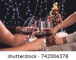 friends celebrating christmas... | Shutterstock . vector #742006378