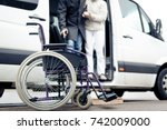 nurse helping senior man exit a ... | Shutterstock . vector #742009000