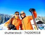 senior couple skiing | Shutterstock . vector #742009018
