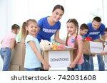 happy volunteers with children... | Shutterstock . vector #742031608