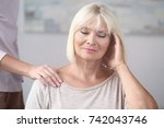 mature woman suffering from... | Shutterstock . vector #742043746