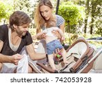 mother father care baby | Shutterstock . vector #742053928