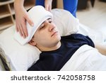 a sick male sleeping with wet... | Shutterstock . vector #742058758