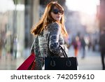 woman during walk on the street ... | Shutterstock . vector #742059610