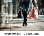 woman on street with shopping... | Shutterstock . vector #742062889