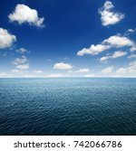 blue sea water surface on sky | Shutterstock . vector #742066786