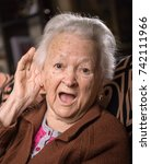 portrait of old woman putting... | Shutterstock . vector #742111966
