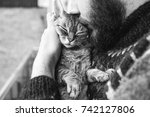 Stock photo cat and man portrait of happy cat with close eyes and young man handsome young animal lover man 742127806